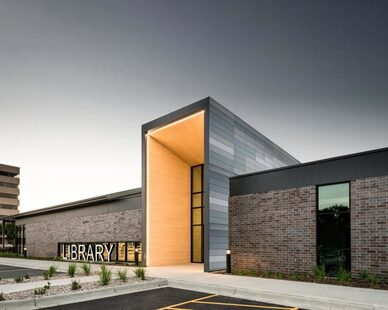 The beautifully illuminated entrance to The K.O. Lee Aberdeen Public Library in Aberdeen, South Dakota, by CO-OP Architecture.