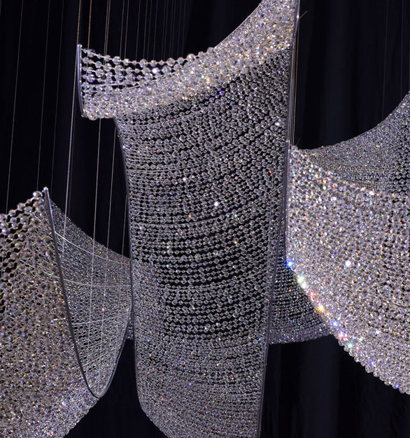 Swarovski crystal designed this light fixture to emulate the ocean which fits perfectly with The Mansions at Acqualine luxury residences in Miami, FL.