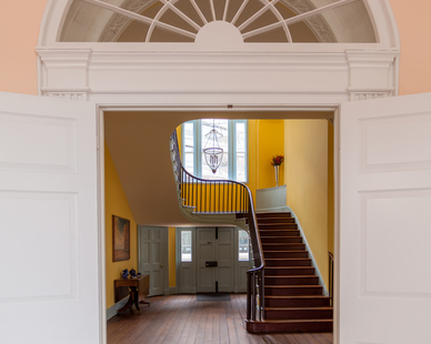 The double doors that separate the Entry Hall from the rest of the house were added by President Madison in 1814. Originally the Entry Hall moved directly into the Stair Hall through a decorative arch. The doors were added as an extra layer of security for the president's home.