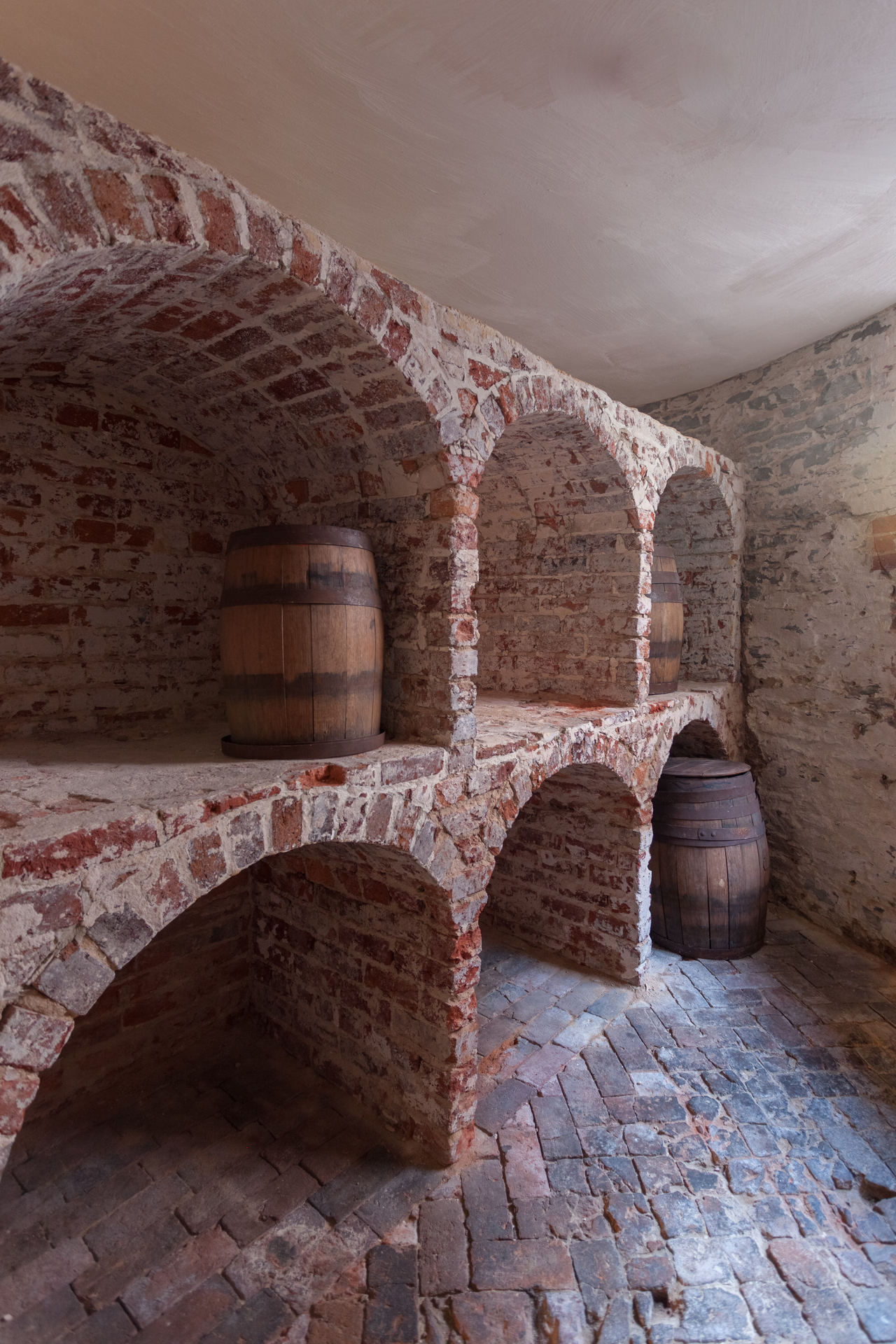 """The presence of a vaulted storage area is evidence that this was the Octagon's wine cellar.  Families like the Tayloes, who entertained frequently, placed great importance on being able to serve a wide variety of fine wines and liquors.  Alcoholic beverages consumed by the Tayloes and their contemporaries included wine, champagne, French and fruit brandies, claret, rum, whiskey, and gin as well as ales and beers.  John Tayloe clearly invested both money and time in purchasing the wine for his cellar and thought his collection valuable enough to be included in his will, specifying that, """"I wish my Stock of Liquors & Spirits on hand at my death to be equally divided among all my sons…"""""""