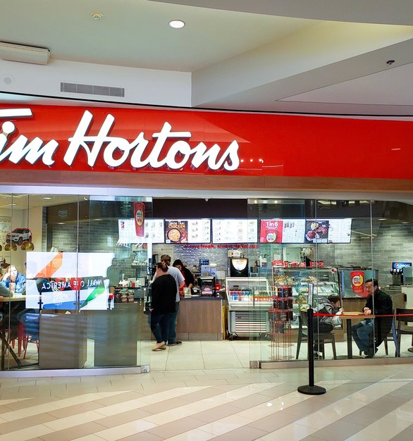 Tim Horton's location at the Mall of America in Bloomington, Minnesota, features Evolution Glass by InVision Glass Design.