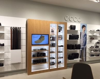 Sleek and sturdy retail display shelves for one of ecco's Tanger Outlet retail locations.
