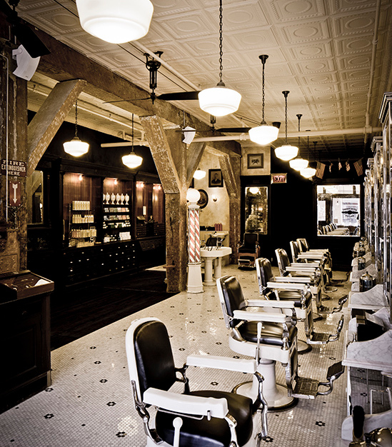 Beautiful penny tile and white tin ceiling tiles adorn this vintage inspired salon.