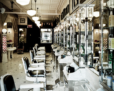 Walk into this gorgeous salon, complete with tin ceilings, vintage-inspired barber chairs and even a classic barber pole.