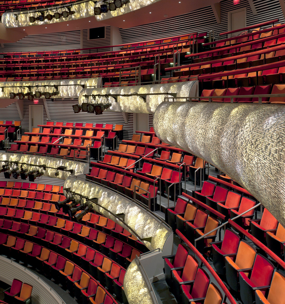The design intent of the panels was to create a dynamic warm flowing visual form. Mark Raissen conceptualized a series of 39 panels constructed with 3-Form Varia Ecoresin Texture Way to create the textured, formed the design of each panel located throughout the auditorium balcony.