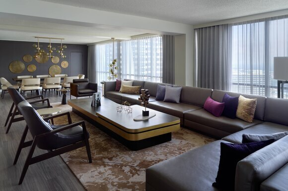 Today, the Atlanta Marriott Marquis is looking better than ever after a dramatic transformation that introduces stylish new amenities and innovative features at every turn.  Suite Room Couch.