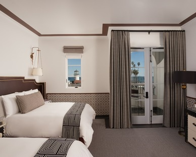 The 121 guest rooms at Hotel Californian Santa Barbara feature four separate designs with monochromatic bases and pops of jewel tones and studded leather.