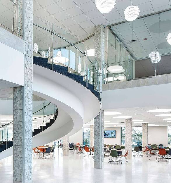 The circular spiral staircase at the Gulfport Transit Center was created using Glasshape's Temper Shield Toughened Curved Glass.
