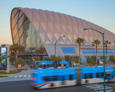 The transportation center has a unique curved roof and large glass facade. The image was captured by Ferrari Images