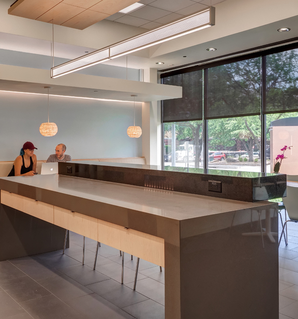 Renovation by David Benners Architecture that expanded the breakroom, meeting area, and collaboration space.