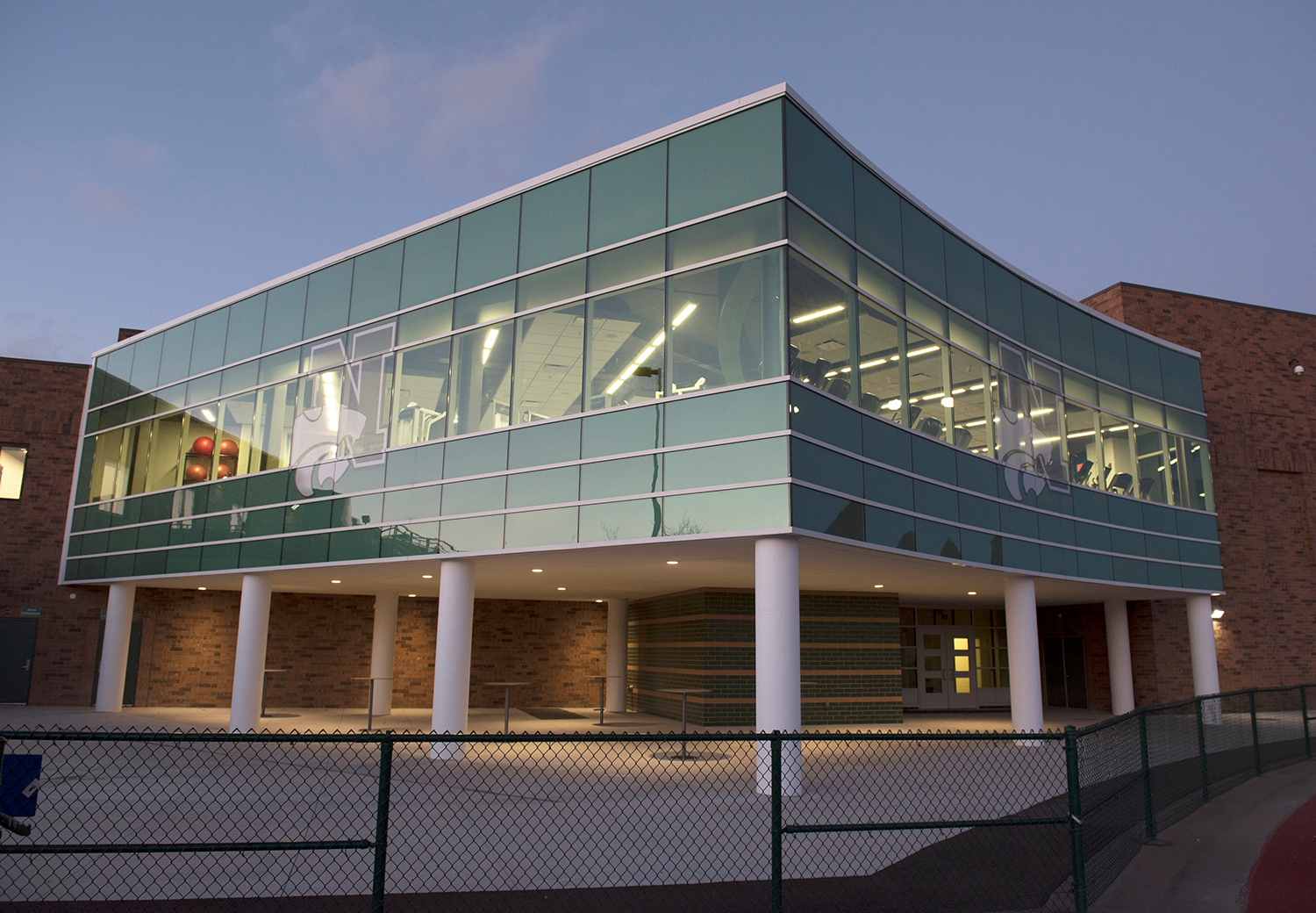 Novi High School features Tubelite's reliable 400 Curtainwall system with Bone White Paint finish.