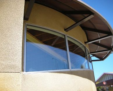 Transit Centers windows are custom designed SCW 660 series fixed window with a declining curve.