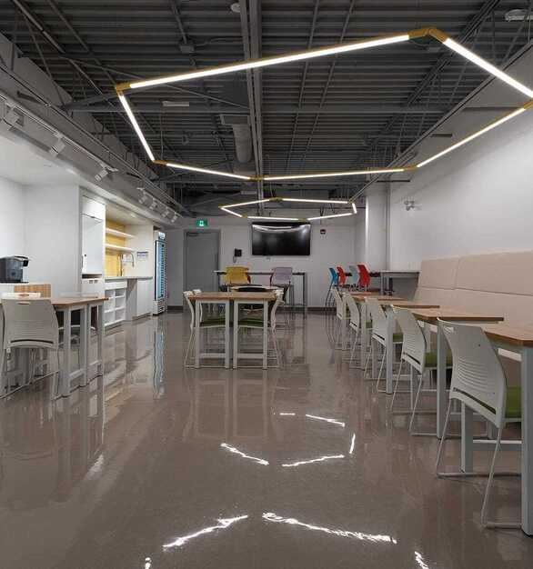 Illuminate workspaces with directional gradients, add interest to grid ceilings with clusters of different forms, control dimming with nLight® and nLight® AIR, consider a splash of color with CCT Contrast™, or customize lighting even further with Tunable White.  Photographer: Michael Tenaglia