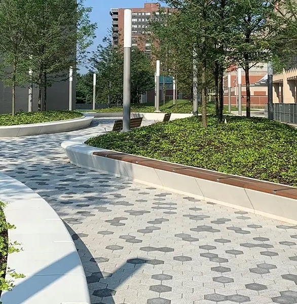 Wausau Tile's custom precast concrete was seamlessly integrated into the plaza's nature heavy designs. From the structured seat walls that surround the grassy knolls, to the walkway steps leading visitors from building to building, our precast concrete helps visitors navigate the plaza safely.