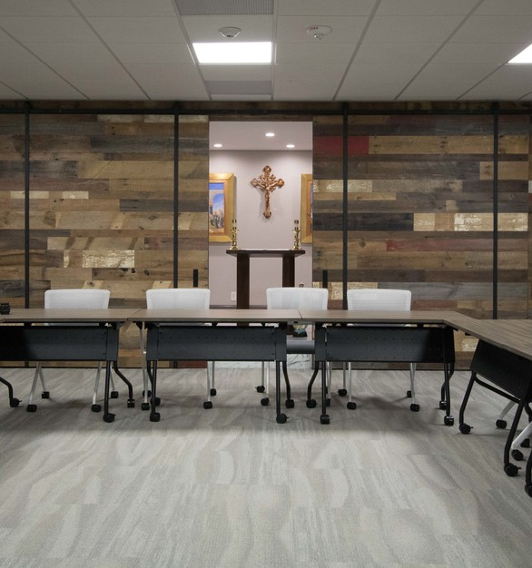 The Catholic Charities offices feature a mixed wall paneling design with various types of wood by Urban Woods Company.