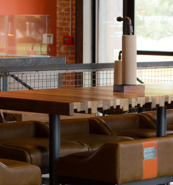 Custom butcher board tables by Urban Woods Co perfectly compliment the rustic design at Butcher Board restaurant.