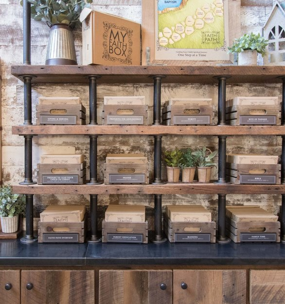 Custom hardwood shelving using reclaimed oak by Urban Woods Company, creates an eye-catching, modern design at Home Pointe in Rockwall, Texas.