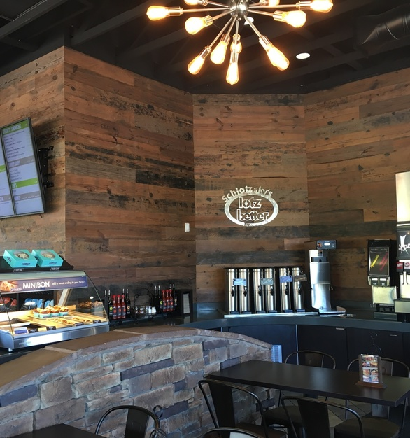 Rustic pine paneling by Urban Woods Co creates a welcoming environment at Schlotzsky's.