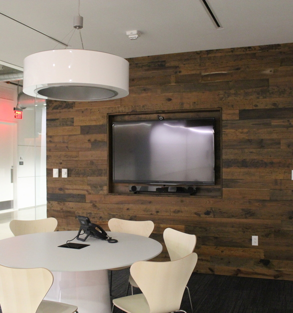 Reclaimed vintage pine accent walls by Urban Woods Co gives a warm and welcoming feeling at The Richard Group office.