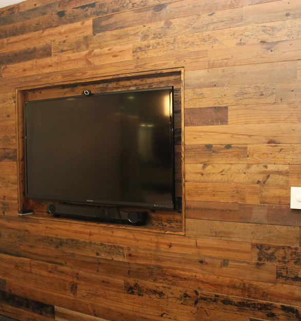 Reclaimed vintage pine accent walls by Urban Woods Co give a warm and welcoming feeling at The Richard Group office.