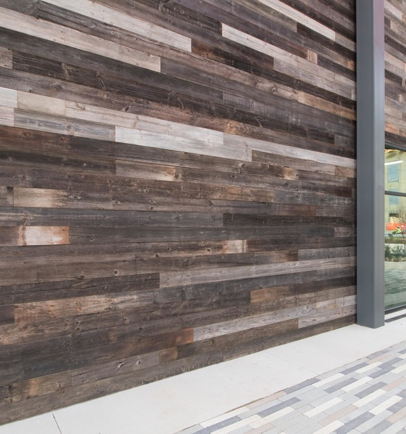 The Sound Texas features dynamic wood paneling in different shades of grey, by Urban Woods Company.