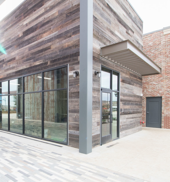 The eye catching exterior paneling creates an inviting environment for guests at The South in Texas, by Urban Woods Company.