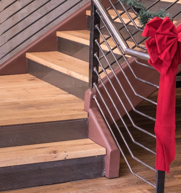 The Ridgemont Construction offices features a stairway lined with Antique Oak Sunset Bay, by Urban Woods Company.