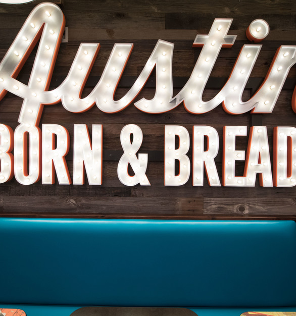 The Grey Pine wall paneling pops next to the marquee lettering at Scholtzsky's Austin Eatery, by Urban Woods Company.