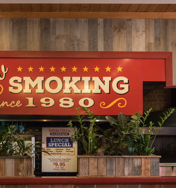 Spring Creek BBQ features Urban Woods Company wall paneling to create an inviting atmosphere for guests to dine in.