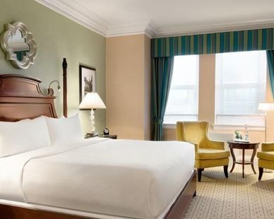The mirror located above the bed was provided by John G. Bagley, who is the representing manufacturer of Uttermost, at the Fairmont Château located in Laurier, Ottawa.