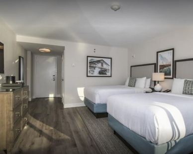 The ceiling light in the entrance, as well as the light on the nightstand, was provided by John G. Bagley who represented Uttermost at the Hilton Wilmington Riverside Hotel located in Wilmington, NC.