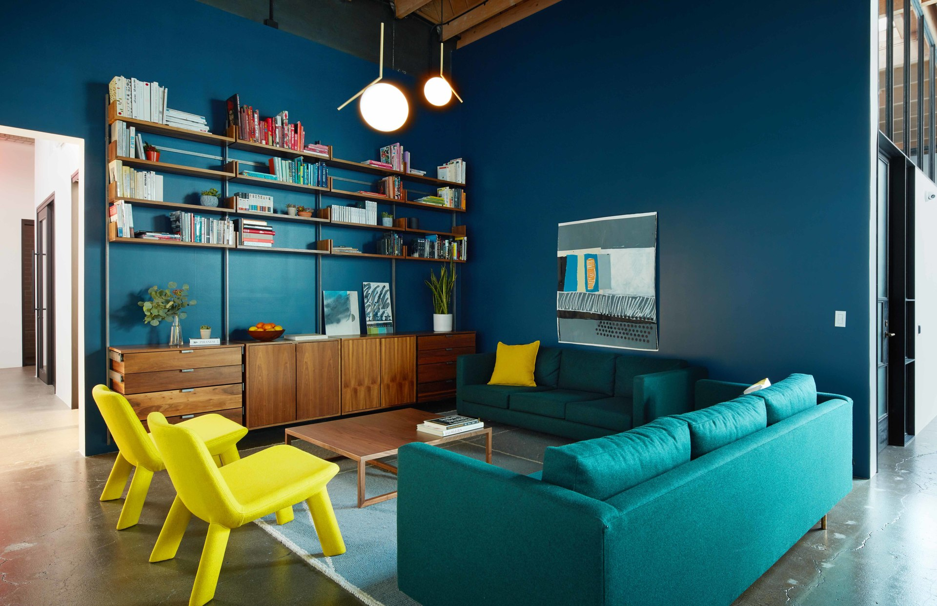 Meeting areas throughout the Psyop office include tables with benches that double for storage and others with couches, chairs and a lounge-like atmosphere.   Photography Credit: McNulty Photo