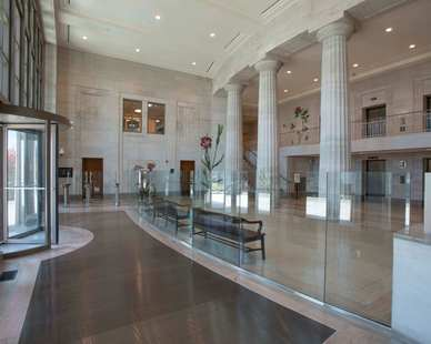 Silver Shadow, by Vetter Stone, is an oolitic limestone with a cool, contemporary, gray tone background and subtle wispy charcoal veining. Shown here in the Mobile, Alabama Courthouse.  Photo Credit: Hartman-Cox Architects