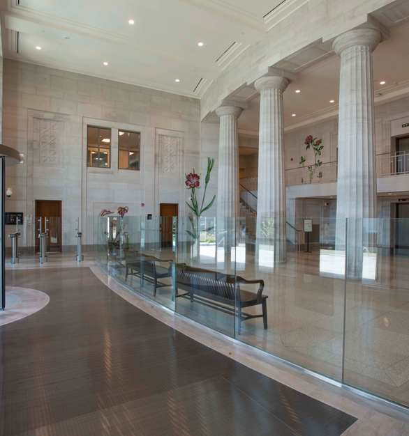 Silver Shadow, by Vetter Stone, is an oolitic limestone with a cool, contemporary, gray tone background and subtle wispy charcoal veining. Shown here in the Mobile, Alabama Courthouse.