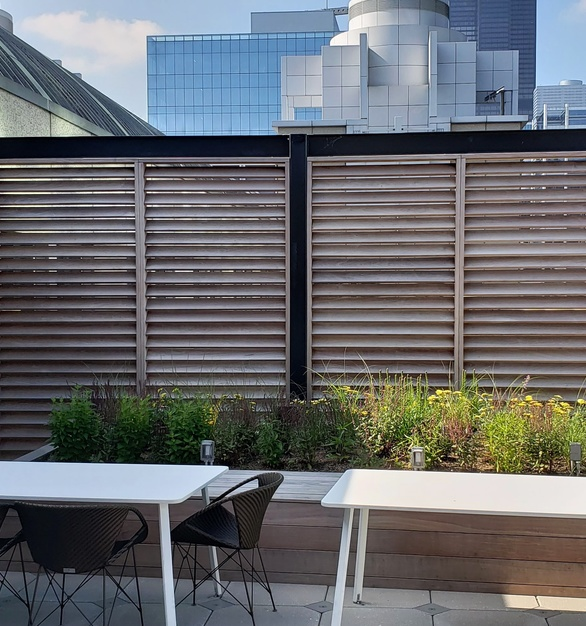 Beautiful patio at Wacker Drive with a semi-intensive green roof by Green Roof Solutions.