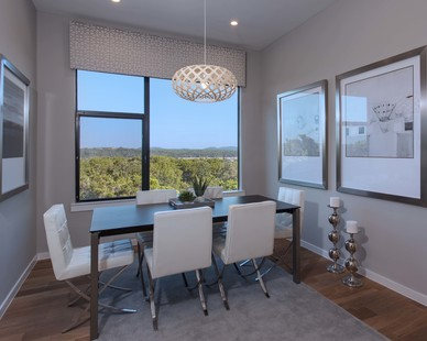 The dining room in the Waterfall Condos on Lake Travis by Cornerstone Architects.