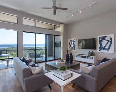 The living space with a view at the Waterfall Condos on Lake Travis b Cornerstone Architects.