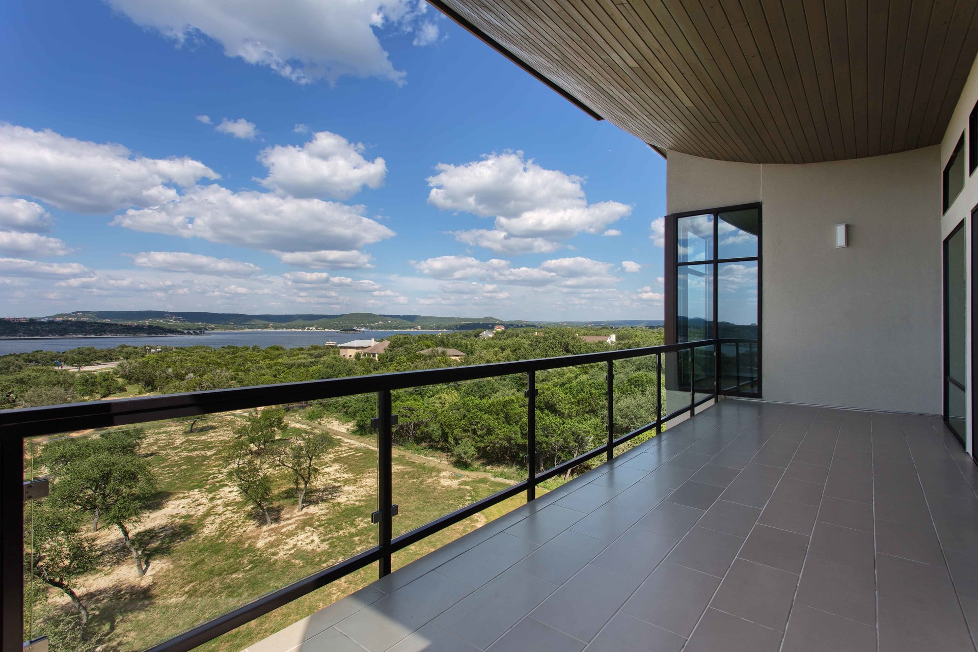 Condo room balcony at the Waterfall Condos on Lake Travis by Cornerstone Architects.