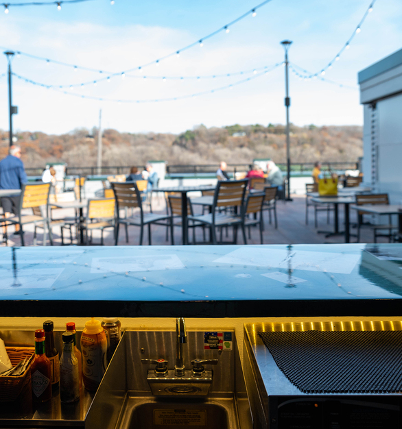 Granicrete Minnesota's backlit countertops adorn Water Street Inn's rooftop bar. The poreless quality of Granicrete makes it durable for outdoor use.