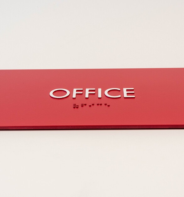 White copy on a burgundy acrylic sign by Welch Sign.