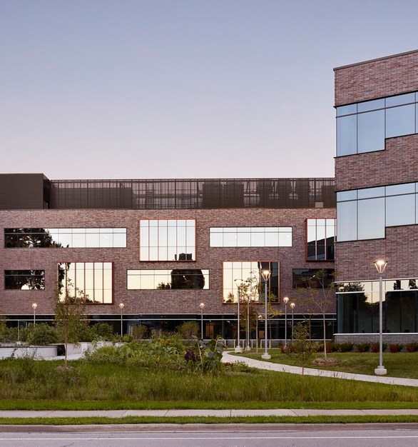 The exterior façade features Endicott thin brick embedded in precast concrete to provide the visual appeal of traditional masonry with the durability and economy of precast.  Wells Concrete provided 294 pieces of 10 1/2″ insulated precast panels with cast-in Versa-Brix® 3D thin brick inlay system from Architectural Polymers.