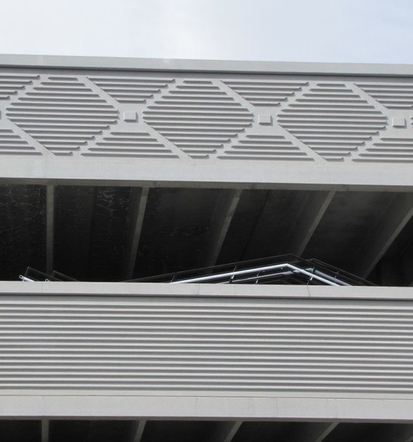 Wells Concrete re-designed the brace frames in to full height elements with steel kickers and varying thicknesses, all plant produced.  This solution reduced piece counts and installation time for Coors Field Parking Structure in Denver, CO