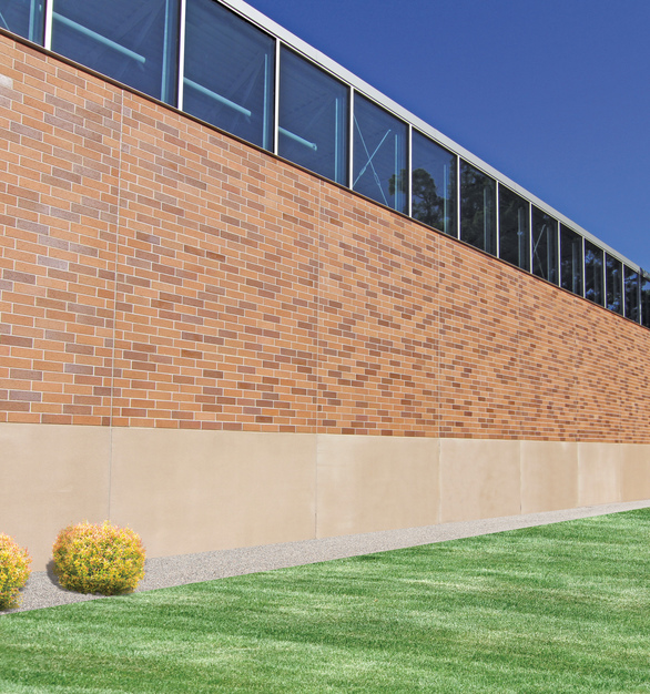 The exposed brick design of the Shivers Basketball Practice facility at Drake University, featuring insulated wall panels by Wells Concrete.