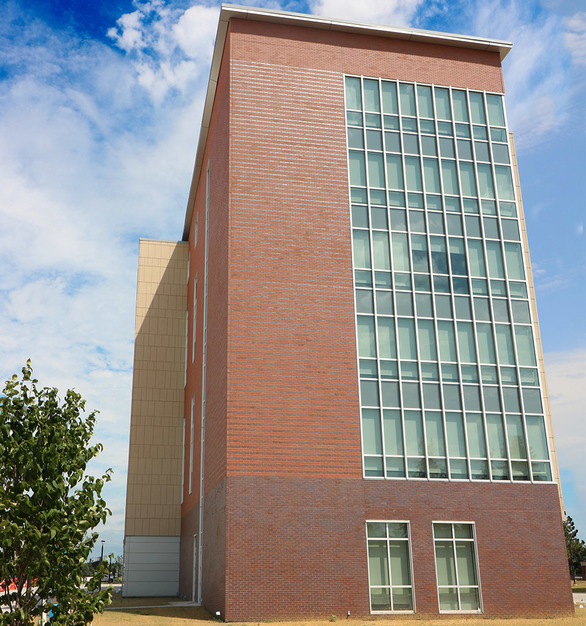 The window design and brick exterior create a modern and durable finish for the NDSU Residence Hall. This project features architectural wall panels by Wells Concrete.