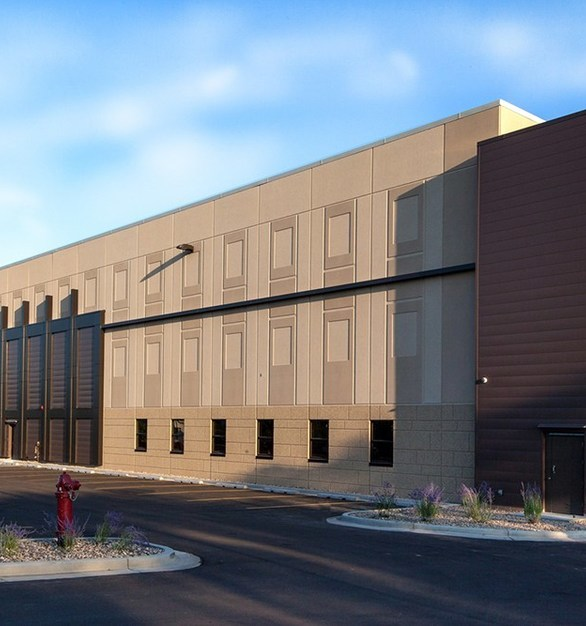 The new three story addition of Williams County Jail provides expanded space for law enforcement and various other county and state departments, including new office and support areas, a vehicle sallyport and indoor vehicle storage garage, and evidence processing by Wells Concrete.