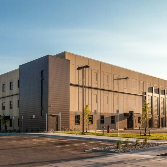 The new three story addition of Williams County Jail provides expanded space for law enforcement and various other county and state departments, including new office and support areas, a vehicle sallyport and indoor vehicle storage garage, and evidence processing by Wells Concrete