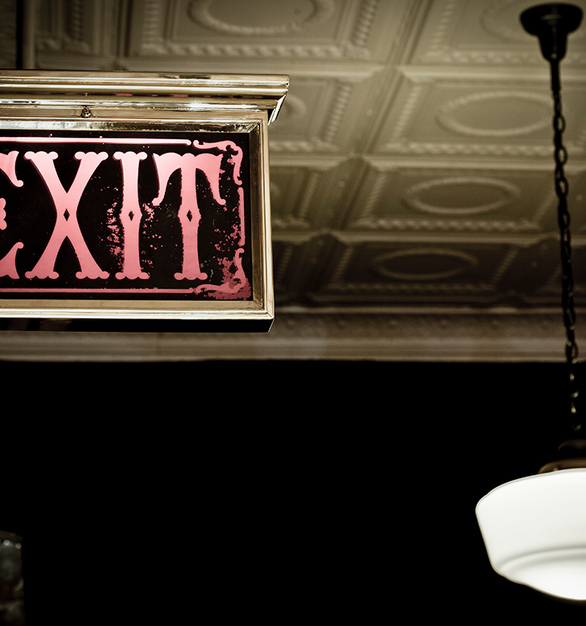 Lighted vintage inspired Exit sign and white tin ceiling tiles.