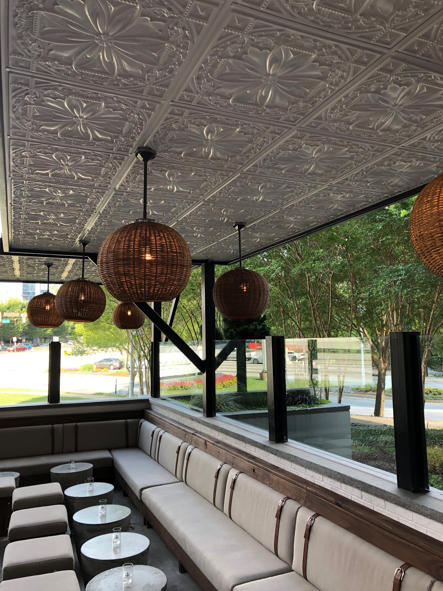 Have a drink and admire the white tin ceiling tiles and hanging lights.