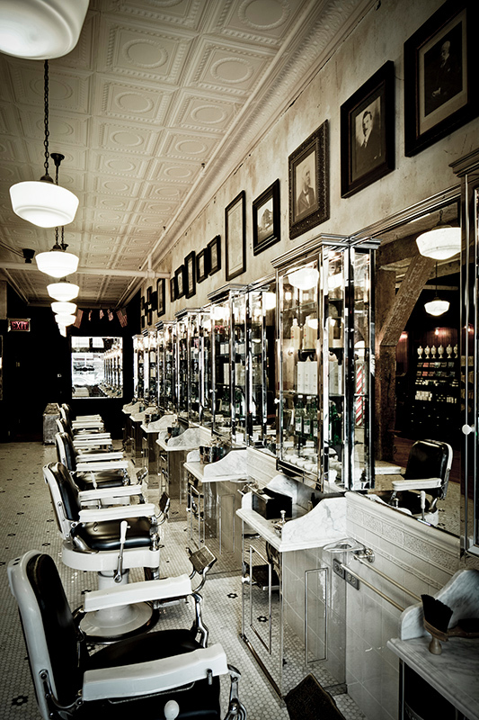 Classic tin ceiling give this vintage-inspired salon the perfect touch.