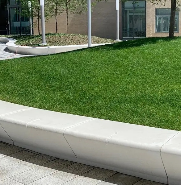 The urban courtyard has Wausau Tile precast concrete seating throughout the entire space for plenty of seating for guests.